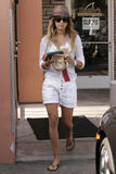 http://img213.imagevenue.com/loc16/th_90357_Ashley_Tisdale_leaving_Coffee_Bean_in_Los_Angeles_290708_08_123_16lo.jpg